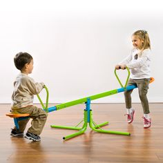 Pure Fun 360 Swivel Kids Seesaw Multi - Help your children soar to new heights with the Pure Fun Kids Swivel See Saw Toy. Ideal for younger children, this see saw doesn't just go up and down, it spins as well, for fun that's out of this world. Kids Seesaw, Field Day Games, Best Baby Toys, Pure Fun, Outdoor Playground, Outdoor Gym, Outdoor Spaces, Play Equipment, Play Houses