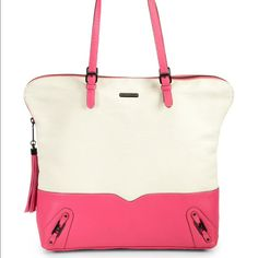 """Host Pick Rebecca Minkoff Zip Top Tote Considering reasonable offers! Authentic Rebecca Minkoff white and pink tote. Off-white canvas with pink pebbled leather accents. Zip top closure with tassel. Three open inner pockets and one zippered inner pocket. Measures approx. 16"""" wide by 15"""" high. Very roomy. Slight wear on the bottom corners. The canvas part is unfinished canvas and therefore looks slightly rugged. Overall in very good condition. Rebecca Minkoff Bags Totes"""