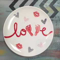 Little foot prints form this LOVE plate with heart and lip stamps available at our Paint your own Pottery Studio-Art by You at Weirdgirl Creations Pottery Studio in Barrington RI Stop by and get creative!