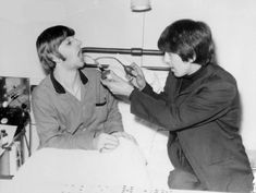 cute photo of George and Ringo when he was in hospital with tonsilitis.