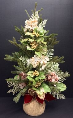 Faux Table Top Christmas Tree: Mauve mini hydrangea picks on burlap sack with red ribbon. Original design & arrangement by http://nfmdesign.synthasite.com/
