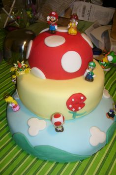 My daughter's Super Mario Birthday Cake. 2 days, a bunch of food coloring and a ton on rolled fondant.