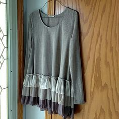 Ruffle layered tunic Nice soft sprung muted lavenders with baby doll layers. Lightweight and breezy but not see through.  I bought new on posh just recently but was too small. easel Tops Tees - Long Sleeve
