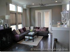 dark grey couch, light grey brown wall