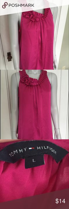 Tommy Hilfiger pink sleeveless blouse Cute tank top is made of a pink satin style fabric with nice ruffle and floral detail at the neckline. Very elegant and great shirt for special occasions! Tommy Hilfiger Tops Blouses