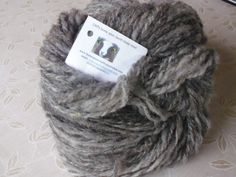 I just finished spinning this lovely naturally grey wool. 900g from the same fleece.