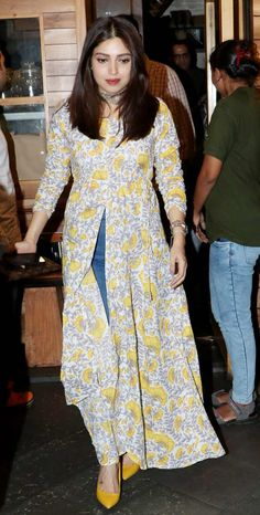 Bhumi Pednekar was all smiles in her yellow coloured slit kurti, when clicked in Juhu, Mumbai. Indian Designer Outfits, Indian Outfits, Frock Fashion, Fashion Outfits, Cute Preppy Outfits, Girly Outfits, Casual Indian Fashion, Stylish Dress Designs, Indian Gowns Dresses