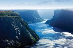 As one of Canada's largest national parks, Gros Morne National Park is fairly unknown by tourists. It's a shame because the Newfoundland coastline . Newfoundland Canada, Newfoundland And Labrador, Gros Morne, Atlantic Canada, Beautiful Islands, East Coast, Wonders Of The World, Places To See, Tourism