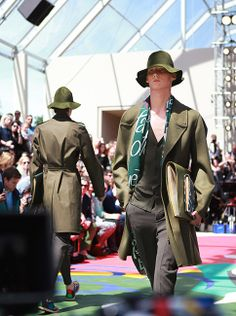 Weather tones of green on a sunny Burberry Spring/Summer 2015 runway in London