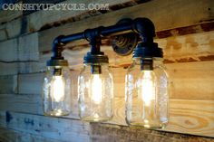 Three Ball Mason Jar Wall Sconce Light Black Iron by ConshyUpcycle