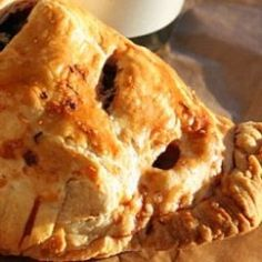 The pasty is a baked pastry casing traditionally filled with diced meat, sliced potato and onion. The pasty came to America by way of Cornwall England. When tin mining started going bad in England during the 1850's the Cornish miners immigrated to the Upper Peninsula of Michigan looking for work in the newly developing iron and copper mines. The pasty came over along with the miners. The miners wives had needed a hearty yet easy to transport and eat lunch for their mining husbands. They came…