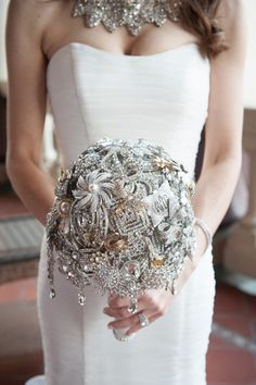 Handmade brooch bouquet she has heavy bling necklace and I dont think its too much, should be ok with my dress then