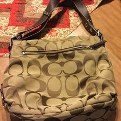 Brown coach shoulder bag Brown coach bag used but in awesome condition.  Has side zipper for storage on outside and zipper side pocket on inside.  Has zipper close and adjustable strap. Authentic Coach Bags Shoulder Bags