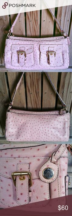 Dooney & Bourke Pink Ostrich Leather Satchel Bag Pre loved Dooney & Bourke Ostrich embossed leather satchel in Pink. No rips, tares, stains or odors. This is such a cute bag. 2 front pockets, and little side pockets on each end of the bag. The inside is done in signature D&B pink with a large zippered pocket on one side & a cell Ph pocket on the other. There is a pink leather key pull inside and & pink leather hang tag outside. Measures- L- 11, H- 6, D- 3, HD- 8.25. This is a MUST have bag…