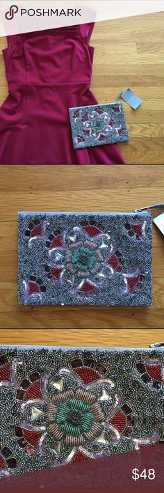 """Anthropologie clutch Gorgeous Radiant Bloom Pouch.  Silver, blush light pink and red beaded floral clutch with zipper.  Perfect for a wedding or cocktail party.  6""""h, 8.75""""w, 0.5""""d. Beaded on both sides.  Reminiscent of elegant Art Deco style. Never used! Anthropologie Bags Clutches & Wristlets"""