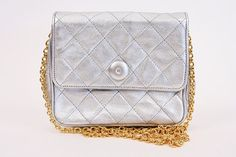 53701287a8ce Vintage CHANEL Silver Mini Bag at Rice and Beans Vintage Vintage Chanel Bag