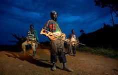 """My photo-project """"Kids"""" seeks to document the humanitarian concerns of child soldiers in the Democratic Republic of Congo.   Child Soldiers. From the series """"Kids"""" © Zoran Marinovic"""