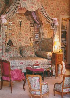 A bed and bedroom covered in a Chinoiserie print chintz. This room is in Paris.Image from The Finest Houses Of Paris.