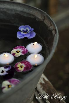 floating flowers and candles in galvanized tub. pansies for grandma :) Floating Flowers, Floating Candles, Water Flowers, Flowers Nature, Haft Seen, Chandeliers, Candles In Fireplace, Pots, Mood Light