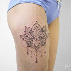 Lotus flower thigh  tattoo by @irenebogachuk