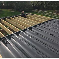 Plastic - The Home Depot Trex RainEscape RainEscape Deck Drainage System 16 ft. Plastic - The Home Depot Under Deck Ceiling, Patio Under Decks, Under Deck Roofing, Pallet Patio Decks, Trex Decking, Deck Patio, Deck Railings, Roof Deck, Railing Ideas