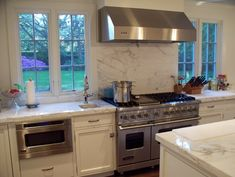 Viking's Undercounter DrawerMicro Oven beautifully matches the Viking 48-inch Dual Fuel Range in this Philadelphia kitchen.