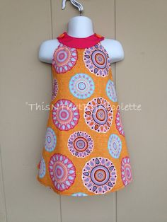 Whimsical Orange and Pink Sundress by ThisNThatByNicolette on Etsy, $22.00