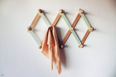 this reminds me of my house growing up, my mom had (still has) a yellow one! this looks like the perfect apron hanger ... teal please!!