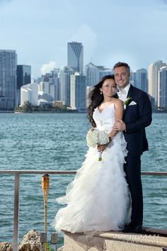#Inlove with this #photo of the #bride and the #groom with the #miami #skyline as a #backgound. Paulynn & Stephane make such a #cute #couple.  #Wedding #photograhy #DominoArts (www.DominoArts.com) #Weddingphotographer #miamiphotographer #luxuryweddings #professionalphotographer #southfloridaweddings #marriage #love #forvever #rustypelican #wedding #weddingphotoideas #miami #skyline