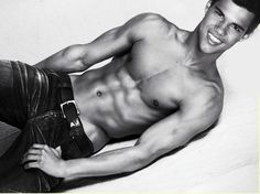 Twilight star Taylor Lautner shows off his hot body in a photo shoot for a magazine cover.