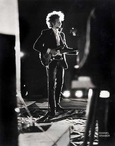 Bob Dylan backlit on stage, Forest Hills Stadium, New York, 1965.