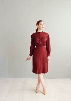 Vintage 1930s deep brick red rayon crepe dress with long wide sleeves that snap at the wrists, covered buttons from the neckline to the bust, a