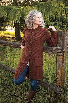 This regal coat is knit in sections from the hem up, then pieced together. Generous pockets and shoulder bands give this knit a professional finish. Knit in bulky wool in simple Moss Stitch, you'll be finished with this garment in no time, and proud to show it off.