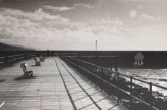 Couple walking on Aberystwyth harbour Pier
