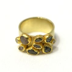 Petra Class, high-karat gold, gemstones. German silver/goldsmith, living in San Francisco,