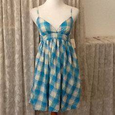 "❌Clearance NWT forever 21 plaid sundress NWT forever 21 blue plaid sun dress. Matching tie back, adjustable strap, elastic panel on back. Measures approx. 35"" from shoulder to hem, laying flat 15""- 16"" across chest, 15"" across empire waist. 100% cotton. Juniors small Forever 21 Dresses"