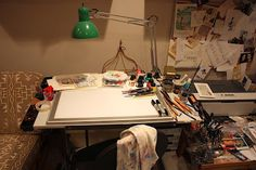 """""""This here is where I do my drawing and painting. Most all of my art is drawn with pen and ink (nib pens and bamboo pens) and colored with watercolor paints. The surface of the desk has a great, big light box or LightPad that I use for going from final, approved sketch, to final, final pen/ink drawings.  . . . """"Mr. Pig Visits . . . Matthew Cordell!"""