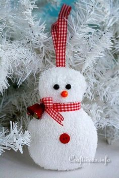 "From the blogger: ""This washcloth snowman is just waiting to be a new addition to decorate a Christmas tree or can be used as a topper for a Christmas gift. The terry cloth fabric gives him such a cute textured look, and he is quick and easy to sew."""
