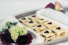 BizBash Idea- Tea Sandwiches for British Themed Events-   British-born chef Ro Howe helms New York's Barraud Caterers. Although the firm tailors menus to individual events, it does have quite a few English classics in its arsenal, like these tea sandwiches, filled with crab-celery salad, beets, and walnut goat cheese butter, and topped with heart-shaped beets.