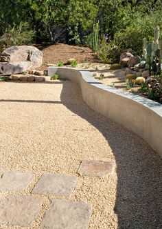 Curved concrete seat wall - stone pavers - seat wall/ retaining wall