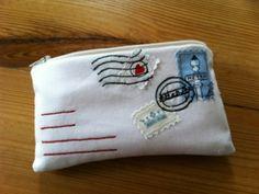 Tutorial:  http://heidiinlederhosen.blogspot.com/2012/02/youve-got-mail-pouch-tutorial.html