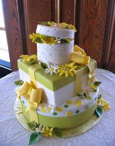 Three tier, green, white and yellow theme gift box wedding cake design, decorated with white and yellow handmade daisies, yellow and pink polka dots and yellow fondant ribbons. Beautiful Desserts, Gorgeous Cakes, Pretty Cakes, Cute Cakes, Amazing Cakes, Cake Original, Gift Box Cakes, Cake Boxes, Gift Boxes
