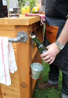 DIY Outdoor Bar via Storefront Life.  I love how compact and functional this is - perfect for the smaller urban backyard.