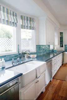 Love white cabinets, black counters and a blue backsplash