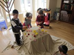 Create Har Sinai. Take a bowl and put it on the table. Drape the bowl and table with a sheet. Now you have a mountain! Pick flowers and tape onto the mountain.  Then add the luchos. Now you are ready to get the TORAH!