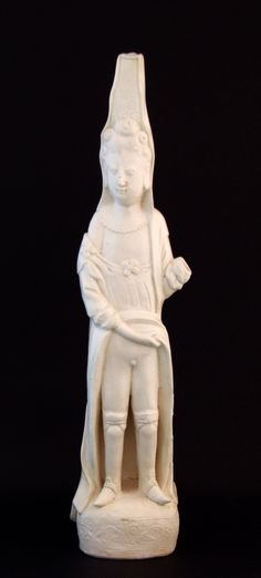 """A Rare Large Kangxi Blanc de Chine Porcelain Model of a Well Dressed Lady Presumed to be a Prostitute or as Donnelly Describes Her a """"Lascivious Woman"""", Dehua Kilns, Fujian Province, Kangxi Period c.1690-1710. This Very Tall Blanc de Chine Figure of a European was Probably Inspired by the Prints of the Bonnart Family (Print Makers and Publishers) of Paris. She is Wearing a `Mantua` Which is Falling off Her Shoulder While She Uses One Hand to Expose Herself."""