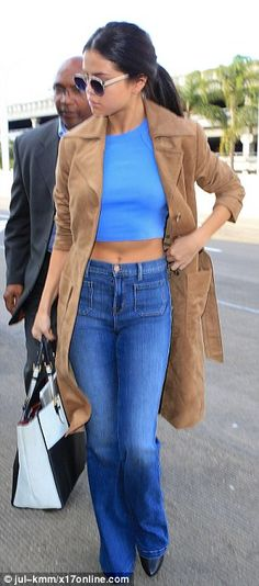 Fashion flare: The Good For You hitmaker rocked a blue crop top along with bell-bottomed jeans