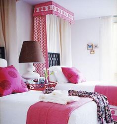 Besides the incredible shades of raspberry, I love the little touches of India in this room...