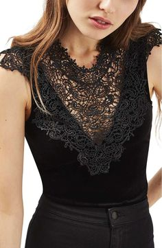 A crocheted lace overlay underscores the vintage look of a velvet bodysuit cut with a dramatic plunging neckline. The stretchy, second-skin fit makes this style perfect for off-duty layering.
