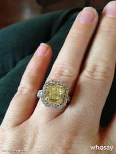 Kelly Clarkson's Engagement Ring -- Yellow canary diamond with diamonds around it.